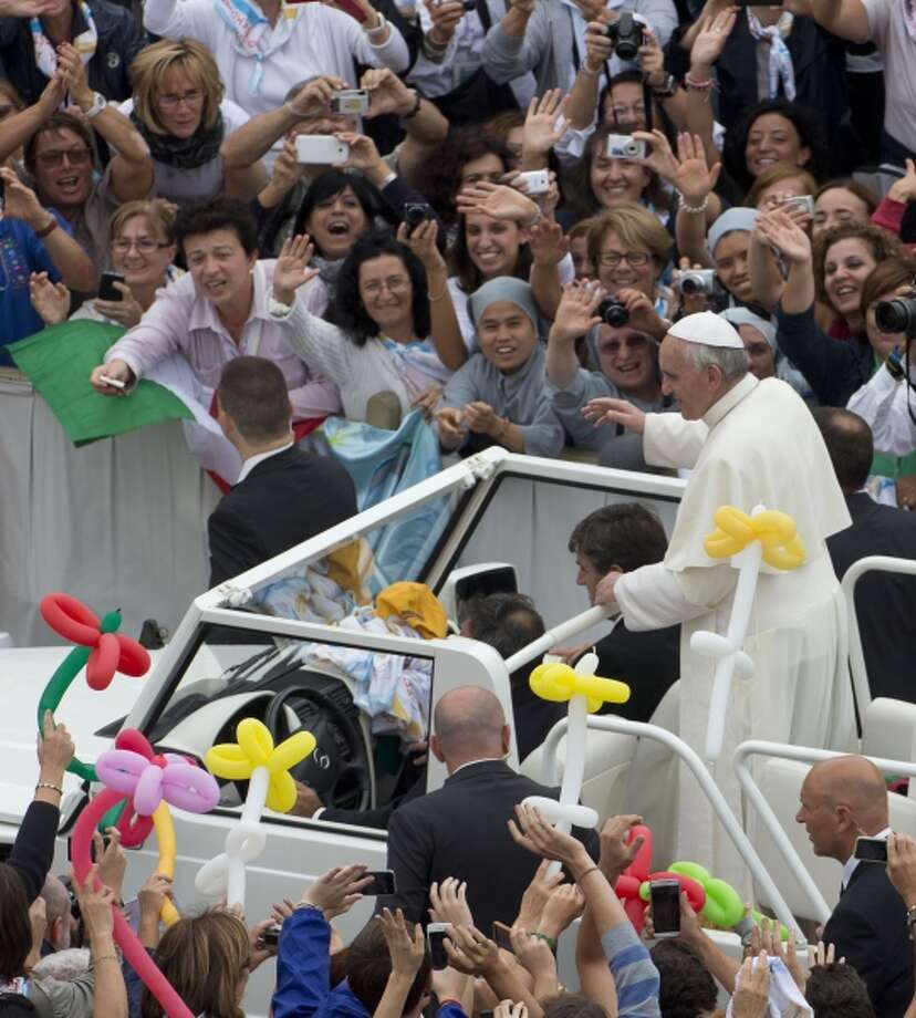 Pope Francis greets the faithful after celebrating a Mass in St. Peter's Square at the Vatican. Photo: AP / AP