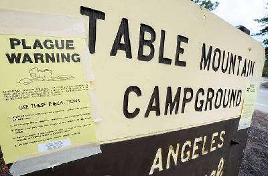 A Plague Warning sign at Table Mountain Campground in the Angeles National Forest on Thursday, July 25, 2013. Crews from County of Los Angeles Agriculture Weights and Measures were spraying Delta Dust to kill the fleas from squirrels and chipmunks around burrow entrances in the Table Mountain Campground area near Mountain High Ski Resort Thursday, July 25, 2013. / Daily Bulletin