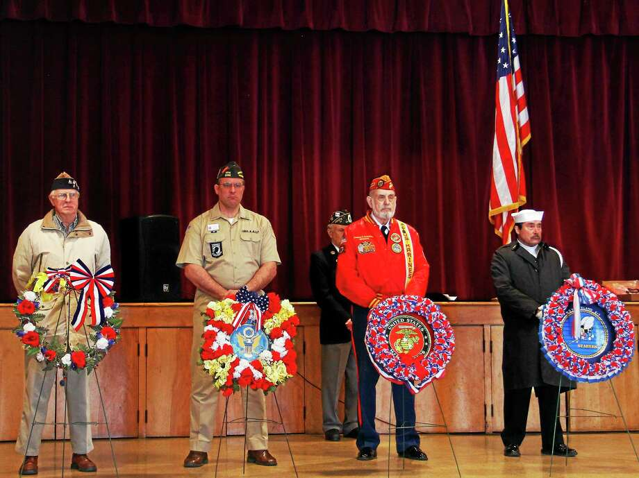Veterans of the four armed forces branches stand in silence in front of wreaths during Torrington's Gulf War Veteran's Day Ceremony at Coe Memorial Civic Center Friday. Photo: Esteban L. Hernandez—Register Citizen