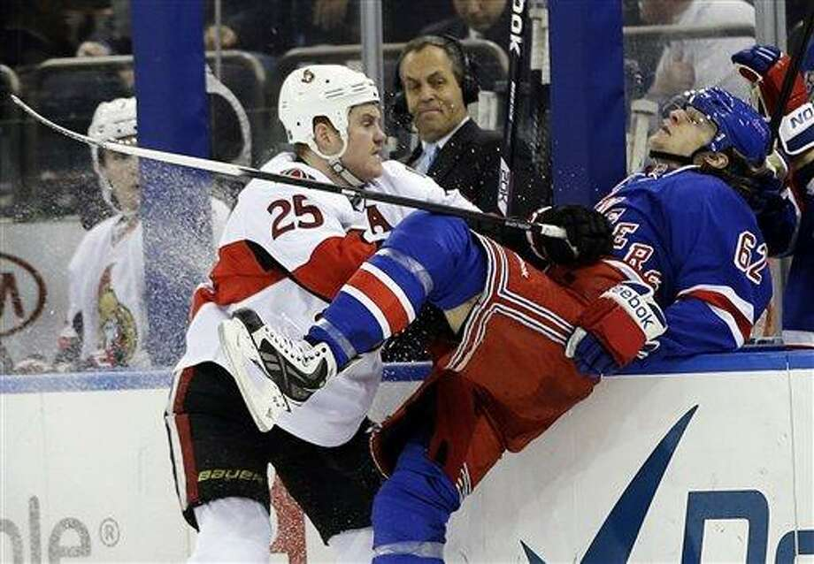 Ottawa Senators' Chris Neil (25) checks New York Rangers' Carl Hagelin (62) during the third period of an NHL hockey game Friday, March 8, 2013, in New York. The Senators won the game 3-2. (AP Photo/Frank Franklin II) Photo: ASSOCIATED PRESS / AP2013