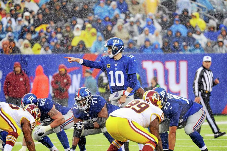 Quarterback Eli Manning and the New York Giants will face the Buffalo Bills in the annual Hall of Fame game on Aug. 3 in Canton, Ohio. Photo: Bill Kostroun — The Associated Press  / FR51951 AP