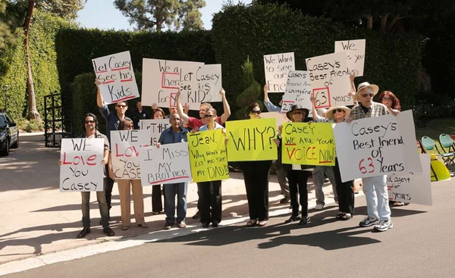 Friends and family of Casey Kasem at a protest involving Casey Kasem's children, brother and friends who want to see him but have been denied any contact, on Tuesday, Oct. 1, 2013 in Beverly Hills, Calif. (Photo by Todd Williamson/Invision/AP)