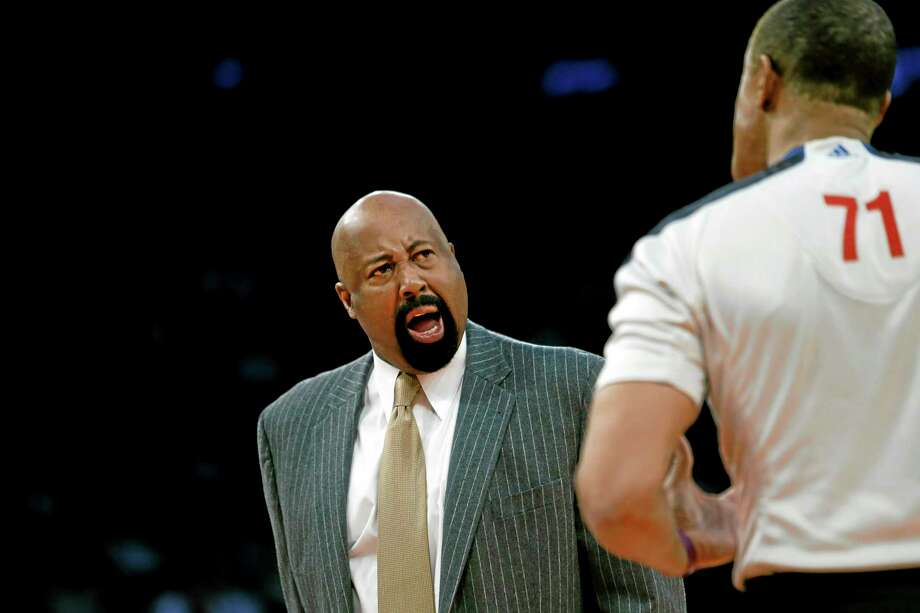 New York Knicks coach Mike Woodson argues with an official during the second half of Monday's loss against the Dallas Mavericks. Photo: Jason DeCrow — The Associated Press  / FR103966 AP