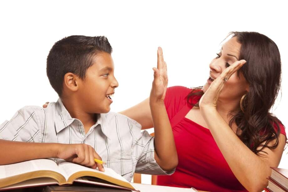 Attractive Hispanic Mother and Son Studying Photo: Getty Images/iStockphoto / iStockphoto