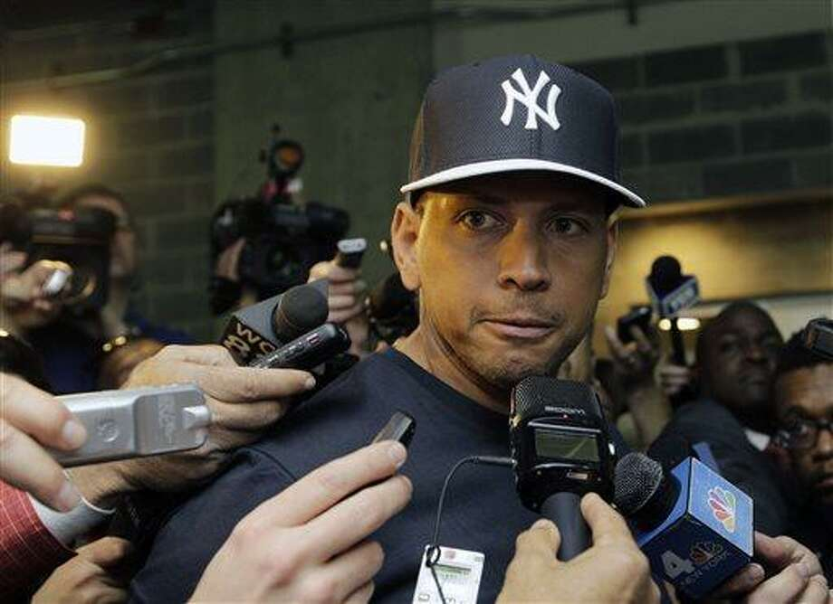 FILE - in this April 1, 2013, file photo, New York Yankees' Alex Rodriguez talks to reporters outside the Yankees' clubhouse in New York. Injuries have kept him off the field for more than half the season and now A-Rod faces discipline from Major League Baseball in its drug investigation, possibly up to a lifetime ban.  (AP Photo/Kathy Willens, File) Photo: AP / AP