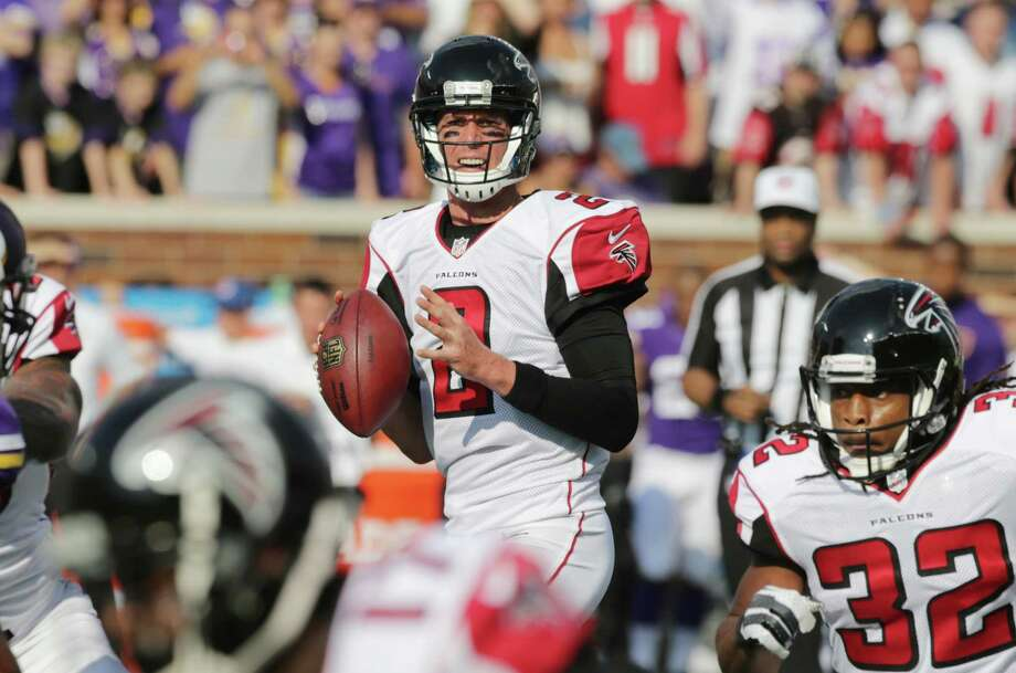 Atlanta Falcons quarterback Matt Ryan looks to pass during last Sunday's 41-28 loss to the Minnesota Vikings in Minneapolis. Photo: Jim Mone — The Associated Press  / AP