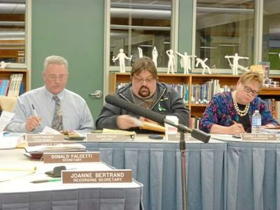Ryan Flynn/Register Citizen (From Left)Board of Education Vice Chair Wayne Shuhi, Chair Frank Simone and Superintendent Deborah Wheeler debate the proposed budget.