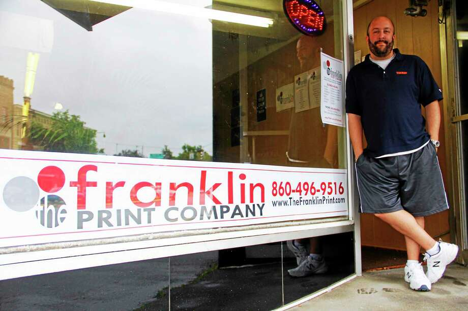 Max Tieman, manager of the Franklin Print Company, stands outside the company's new location on 48 Main St. on Friday in Torrington. Photo: Esteban L. Hernandez — The Register Citizen