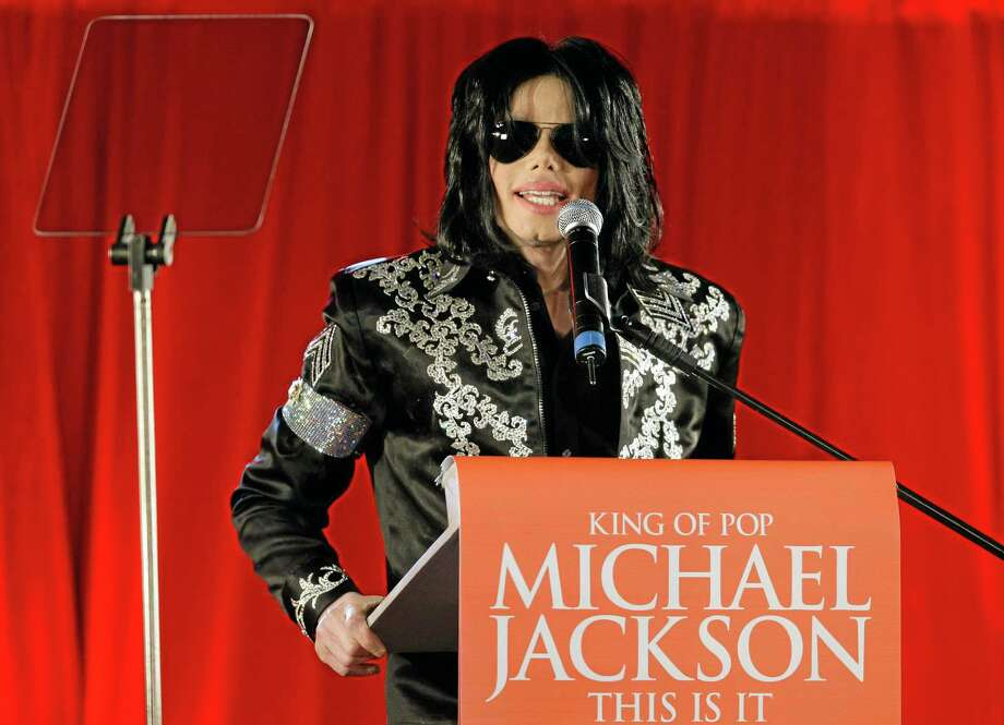 FILE - In this March 5, 2009 file photo, US singer Michael Jackson announces at a press conference that he is set to play ten live concerts at the London O2 Arena in July 2009, in London. A Los Angeles jury reached a verdict Wednesday Oct. 2, 2013, in Katherine Jackson's long-running negligence case against AEG Live LLC, which accuses the concert promoter of being responsible for hiring the doctor convicted of killing her son in 2009. (AP Photo/Joel Ryan, File) Photo: AP / AP