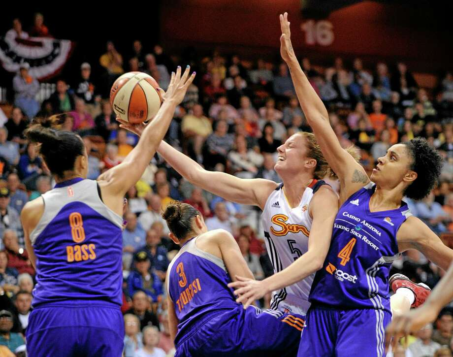 The Sun's Kelsey Griffin is fouled by the Mercury's Diana Taurasi (3) as Mistie Bass (8) and Candice Dupree (4) support during the second half Thursday. Photo: Fred Beckham — The Associated Press  / FR153656 AP