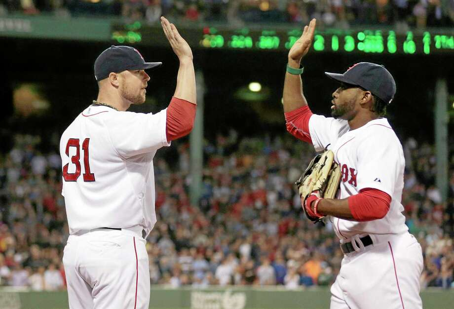 Red Sox starting pitcher Jon Lester, left, congratulates center fielder Jackie Bradley Jr. after the top of the seventh inning Thursday in Boston. Photo: Charles Krupa — The Associated Press  / AP