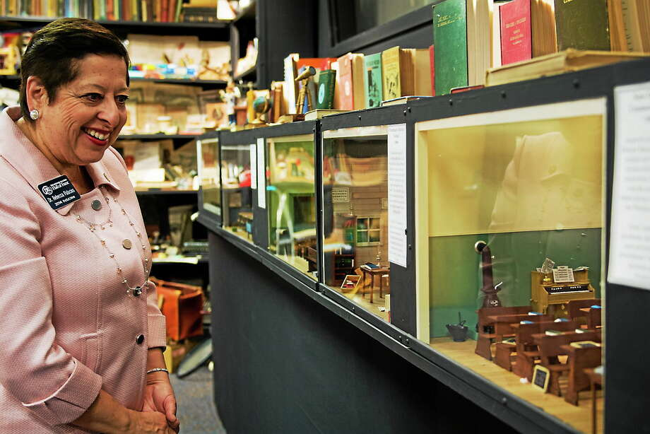 Rebecca Palacios, an early childhood educator from Corpus Christi, Texas, and 2014 inductee into the National Teachers Hall of Fame, walks along a display case of classroom dioramas at the hall in Emporia, Kan. The hall will dedicate a memorial to educators who have been killed on the job. Photo: AP Photo/Emporia Gazette, Dustin Michelson  / Dustin Michelson/Emporia Gazette