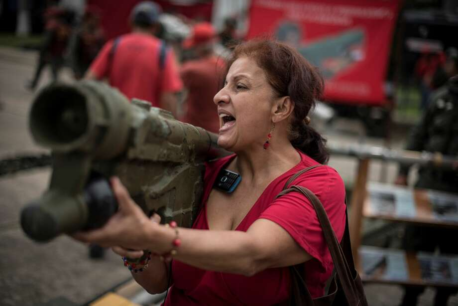 A woman holding a rocket launcher as  part of military drills in Caracas on August 26, 2017. Venezuela kicks off two days of military drills in response to newly announced sanctions on the crisis-stricken nation.  Photo: Anadolu Agency/Getty Images
