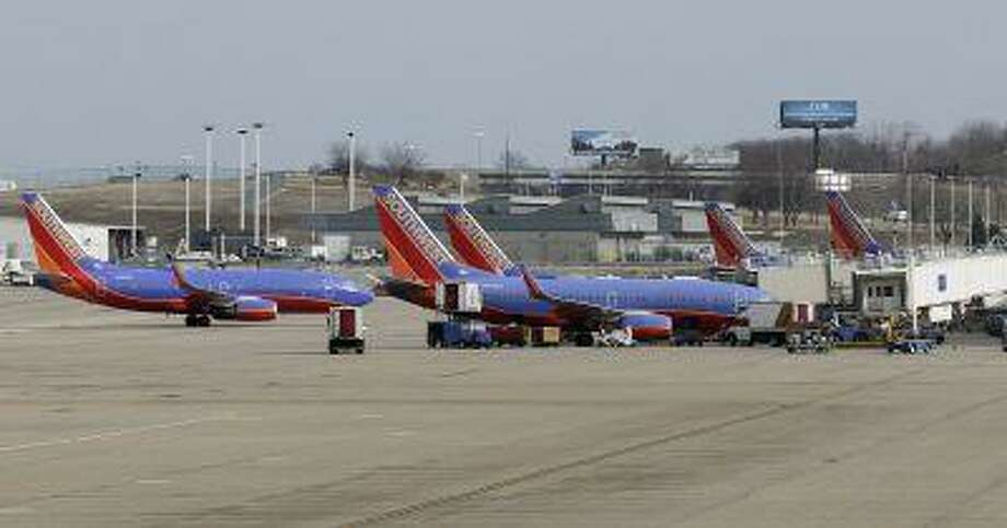 Several Souhtwest Airlines planes are lined up at Terminal two at the Lambert - St. Louis International Airport, in St. Louis, Missouri, in this file photo from March 4, 2013. Photo: REUTERS / X02989