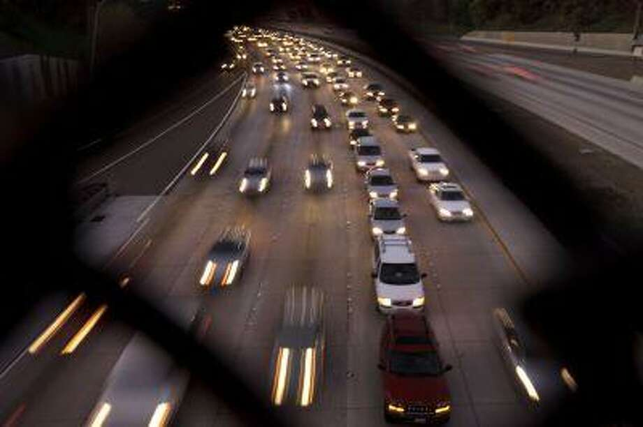 Cars fill the highway Tuesday, Nov. 22, 2011, in San Diego. (AP Photo/Gregory Bull) Photo: ASSOCIATED PRESS / AP2011