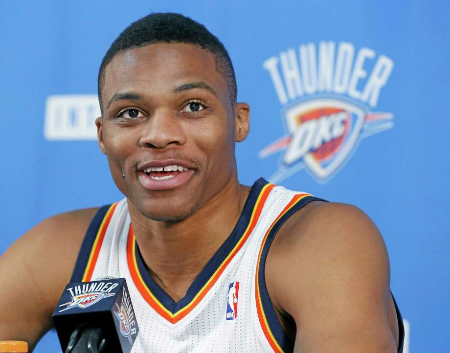 Oklahoma City Thunder guard Russell Westbrook smiles as he answers a question during a news conference during media day on Friday in Oklahoma City. Photo: Sue Ogrocki -- The Associated Press  / AP