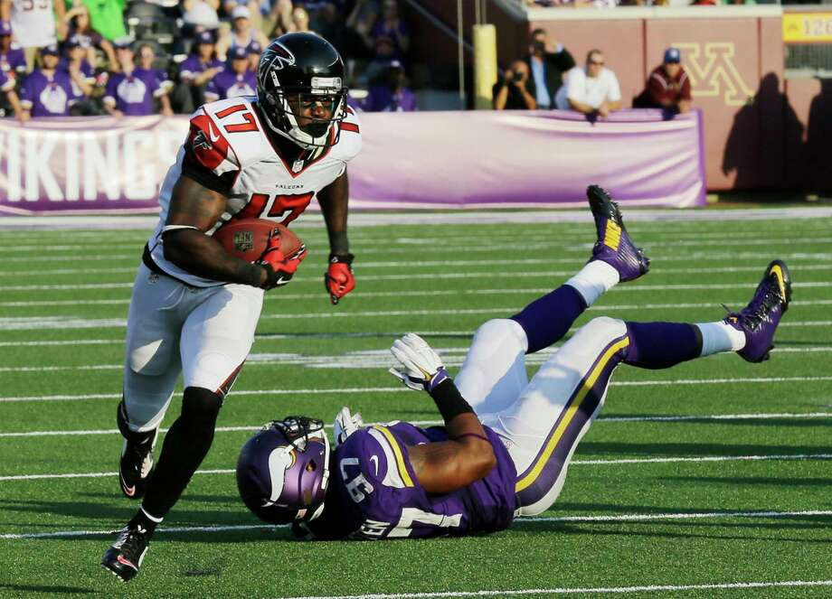 Atlanta Falcons wide receiver Devin Hester (17) runs from Minnesota Vikings defensive end Everson Griffen (97) during a 36-yard touchdown reception on Sunday in Minneapolis. Photo: Ann Heisenfelt — The Associated Press  / FR13069 AP