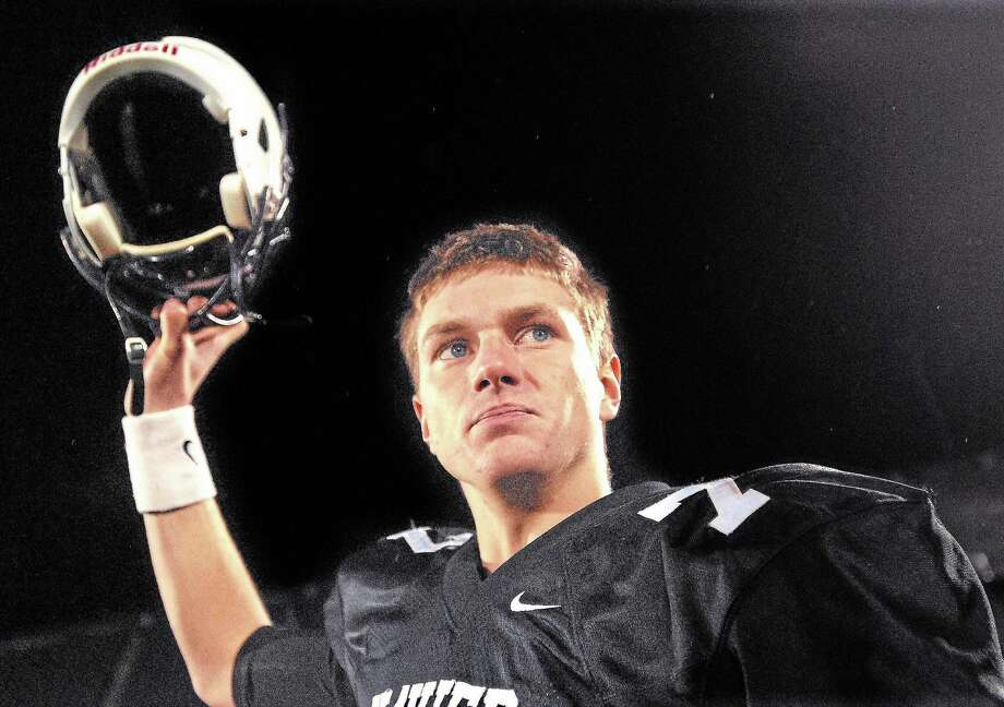 Senior captain Tim Boyle led Xavier to a 48-14 win over Norwich Free Academy in the Class LL state football championship at Rentschler Field in East Hartford. Photo: Catherine Avalone -- The Middletown Press