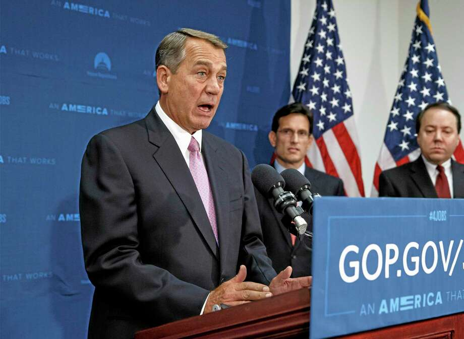 House Speaker John Boehner of Ohio, joined by House Majority Leader Eric Cantor, R-Va., center, and Rep. Pat Tiberi, R-Ohio, talks to reporters earlier this week on Capitol Hill in Washington, after a Republican Conference meeting. Photo: AP FILE Photo — J. Scott Applewhite  / AP