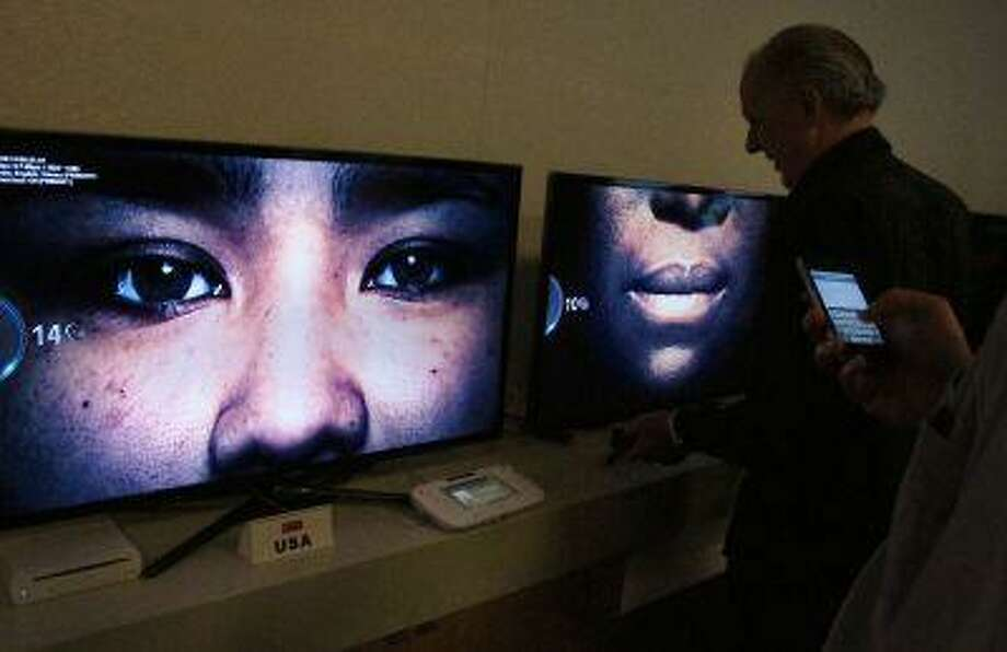 """In this photo taken Wednesday, July 10, 2013, invited guests view the debut of the new series """"Orange is the new black"""" at Netflix headquarters in Los Gatos, Calif. (AP Photo/Michael Liedtke) Photo: AP / AP"""
