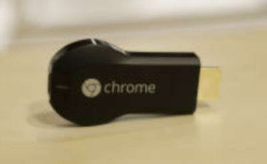 A new Chromecast media device is introduced by Google during a presentation at Dogpatch Studios in San Francisco, Calif. on Wednesday, July 24, 2013. The device allows users to transfer web content directly to the television. (Gary Reyes/Bay Area News Group) Photo: San Jose Mercury News / San Jose Mercury News