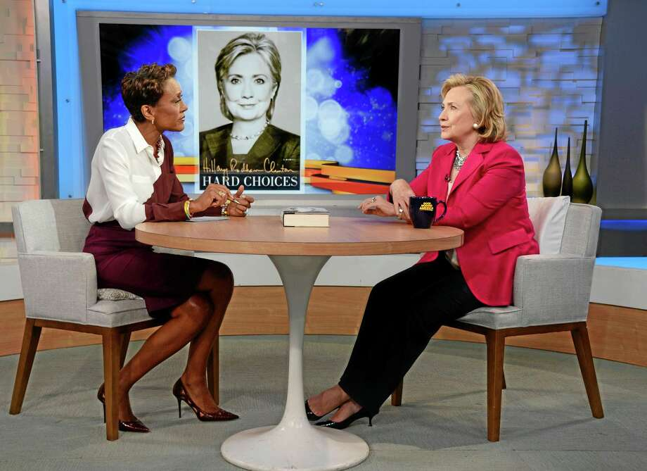 "In this photo provided by the American Broadcasting Companies, Inc., former Secretary of State Hillary Rodham Clinton, right, discusses her new memoir, ""Hard Choices,""†with Robin Roberts during a live interview with Roberts on the ABC Television Network's ""Good Morning America,"" Tuesday, June 10, 2014 in New York.  (AP Photo/ABC, Ida Mae Astute) Photo: AP / American Broadcasting Companies, Inc."