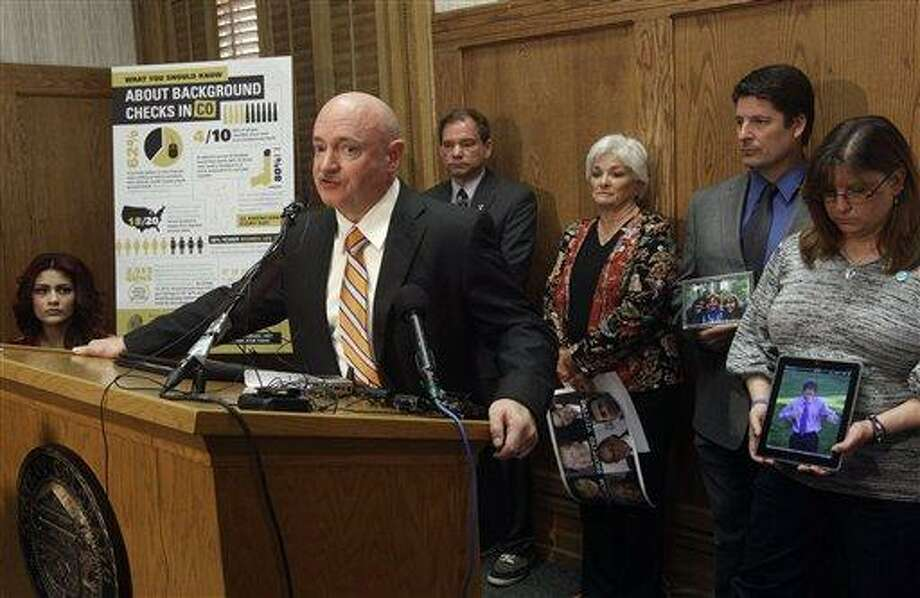 Retired Navy captain and astronaut Mark Kelly, the husband of former U.S. Rep. Gabrielle Giffords, speaks during a news conference in favor of proposed gun control legislation at the State Capitol, in Denver, Monday March 4, 2013. Behind him are, far left to right, Karina Sartiaguin, 18, who was shot in the back outside her high school in 2010, Tom Mauser, the father of Columbine High School shooting victim Daniel Mauser, Patricia Maisch, who helped take away a magazine from the Tucson shooter, Dave Hoover, the uncle of 18-year-old AJ Boik, one of 12 people killed in the Aurora theater shooting, and AJ Boik's mother Theresa Hoover. (AP Photo/Brennan Linsley) Photo: AP / AP