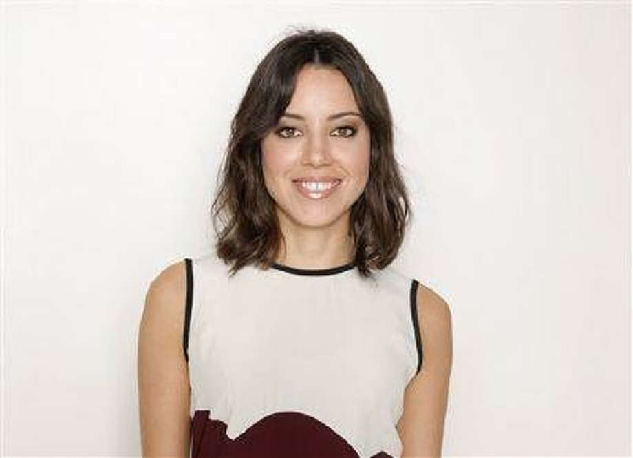 """This Sunday, July 14, 2013 photo shows Aubrey Plaza from the cast of """"The To Do List"""" at the Four Seasons Hotel in Los Angeles. The comedy revolves around a Boise teenager named Brandy Klark, played by Plaza, a valedictorian of the Class of 1993, who creates a """"to do"""" list of the things she missed out on in high school. The film releases Friday, July 26, 2013. (Photo by Todd Williamson/Invision/AP) Photo: Todd Williamson/Invision/AP / Invision"""