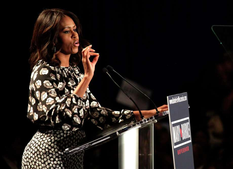 FILE - In this Monday, Sept. 29, 2014 file photo, first lady Michelle Obama speaks on behalf of Wisconsin Democratic gubernatorial candidate Mary Burke at a campaign rally in Milwaukee. Maine gubernatorial candidate Mike Michaudís campaign is getting some help from Michelle Obama. The first lady will be in Maine on Friday, Oct. 3, 2014, at a rally for the Democratic congressman whoís seeking to unseat Republican Gov. Paul LePage.  (AP Photo/Darren Hauck, file) Photo: AP / AP