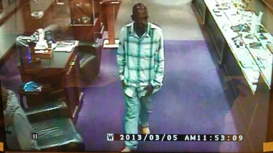 Farmington police photo. Police say they are searching for a man who stole a $40,000 diamond from a Westfarms jewelry store.