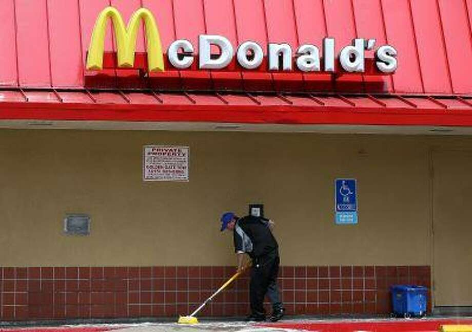 A worker cleans a sidewalk outside of a McDonald's restaurant on July 22, 2013 in San Francisco, California. Photo: Getty Images / 2013 Getty Images