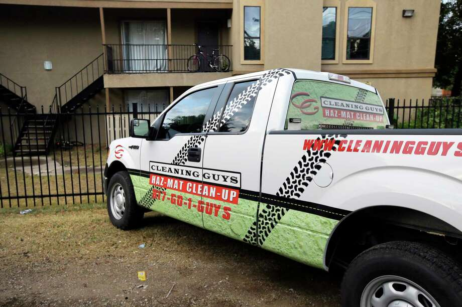 A hazardous materials cleaning company truck sits parked outside The Ivy Apartments, Thursday, Oct. 2, 2014, in Dallas. Dallas city officials asked a family who resides at the complex who had contact with a man diagnosed with the Ebola virus to remain in their home. (AP Photo/Tony Gutierrez) Photo: AP / AP