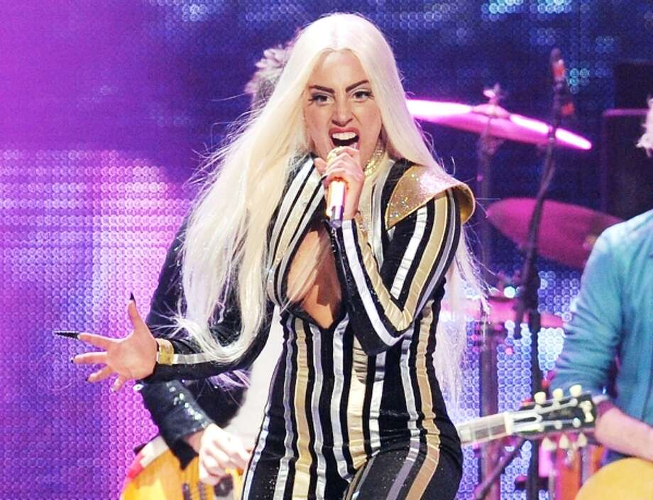 In this Dec. 15, 2012 file photo pop singer Lady Gaga performs at the Prudential Center in Newark, N.J. Photo: AP / 201220122012