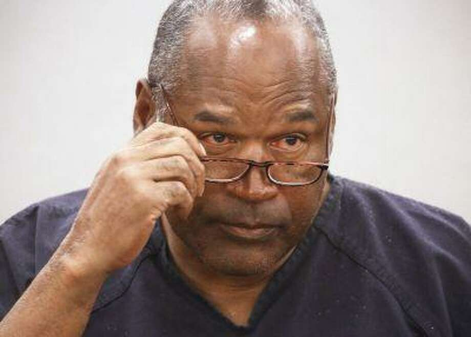 O.J. Simpson takes his glasses off during his evidentiary hearing testimony in Clark County District Court in Las Vegas, Nevada in this May 15, 2013 file photo. Photo: REUTERS / X80003