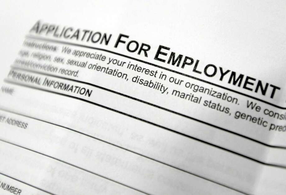 FILE - This April 22, 2014, file photo shows an employment application form on a table during a job fair at Columbia-Greene Community College in Hudson, N.Y. Photo: (Mike Groll — The Associated Press) / AP