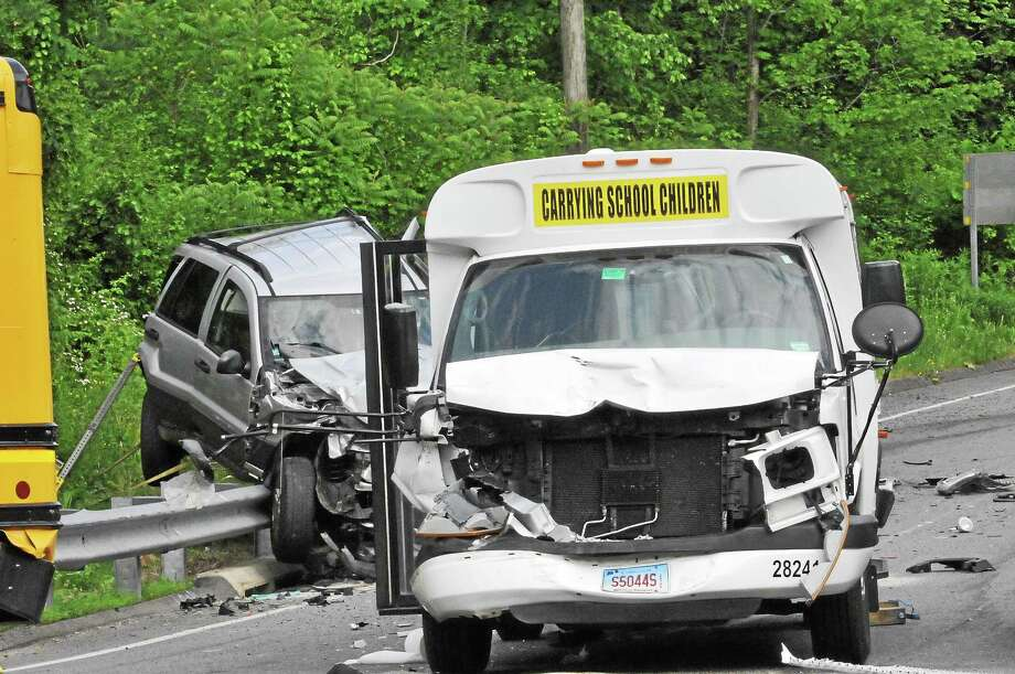 Two buses and three other vehicles were involved in a crash on Winsted Road in Torrington Tuesday. Several children were taken to the hospital as a precaution, but officials at the scene said none were seriously injured. Photo: Laurie Gaboardi — The Register Citizen