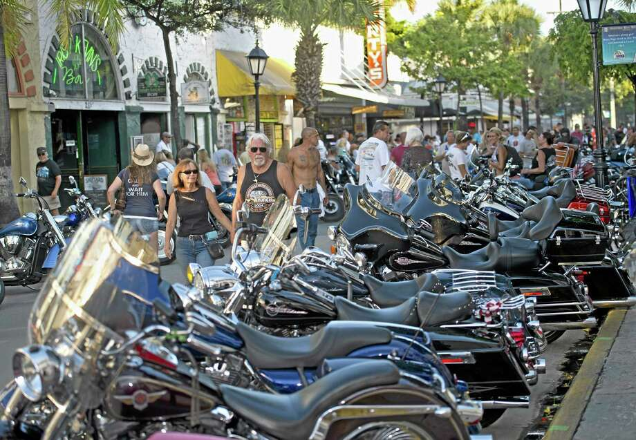 In this Sept. 20 photo provided by the Florida Keys News Bureau, bikers make the news doing good. Participants in the Key West Poker Run inspect the lineup of motorcycles on Duval Street in Key West, Fla. By the end of the event, organizers expected that some 10,000 bikers would have made the trip down the Florida Keys Overseas Highway to raise money for the Diabetes Research Institute and other charities. (AP Photo/Florida Keys News Bureau, Bert Budde) Photo: AP / Florida Keys News Bureau