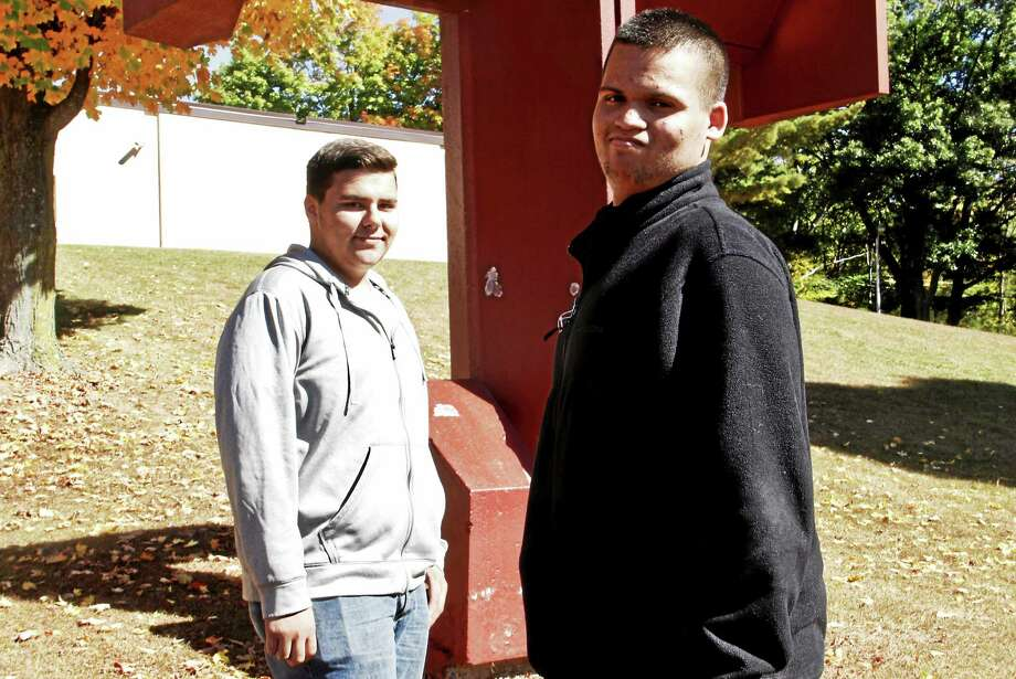 From left: Juniors Nate Kopler and Nick Caro stand outside Torrington High School on Friday, Oct. 3. The 16-year-old students are participating in a state-wide program tracking predators in the area. Photo: Esteban L. Hernandez — The Register Citizen
