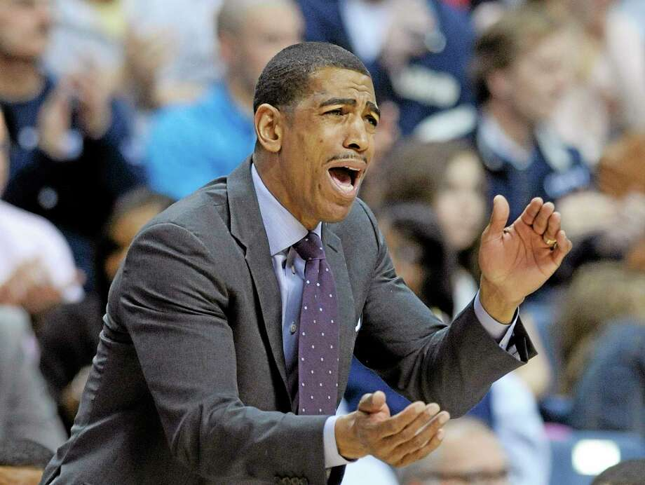 UConn head coach Kevin Ollie and the Huskies notcehd a 61-56 win over South Florida on Wednesday. Photo: Fred Beckham — The Associated Press  / FR153656 AP