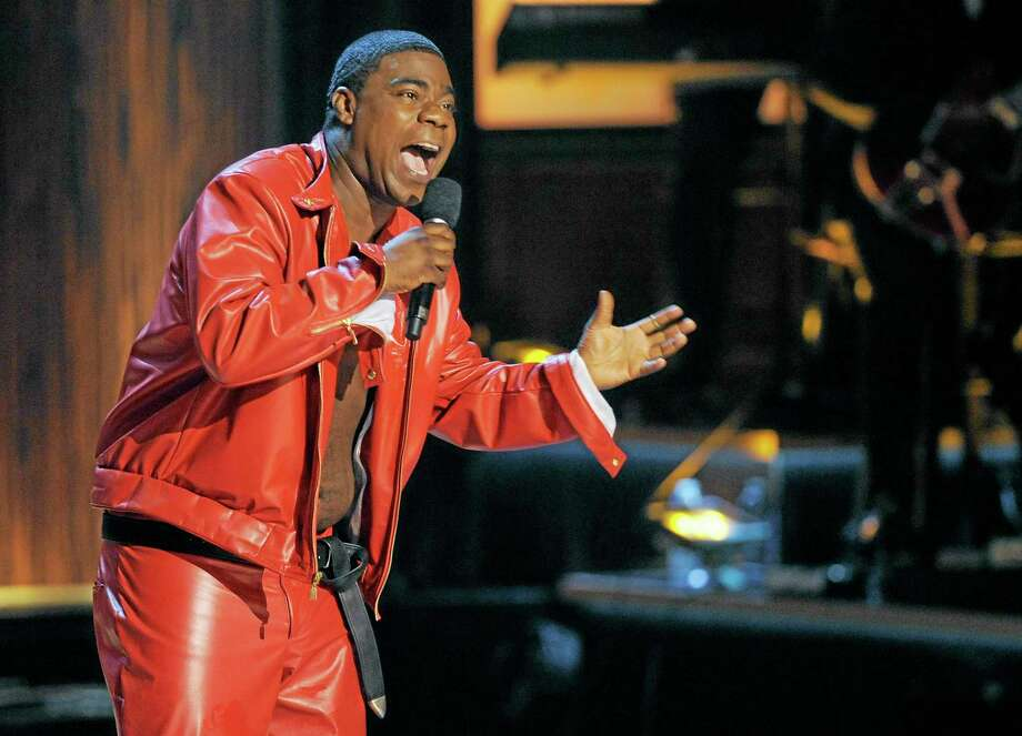 "FILE - In this Nov. 3, 2012 file photo, comedian Tracy Morgan performs at ""Eddie Murphy: One Night Only,"" a celebration of Murphy's career at the Saban Theater in Beverly Hills, Calif. Morgan is recovering but is expected to remain hospitalized for several weeks after having surgery on a broken leg suffered in a chain-reaction crash on the New Jersey Turnpike early Saturday, June 7, 2014, that left two others critically injured and one dead. (Photo by Chris Pizzello/Invision, File) Photo: Chris Pizzello/Invision/AP / Invision"