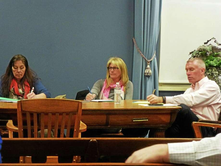 Chairman Karen Beadle, Lois Clough and Bob Passini listen to ideas from the public. Photo: Ryan Flynn — Register Citizen
