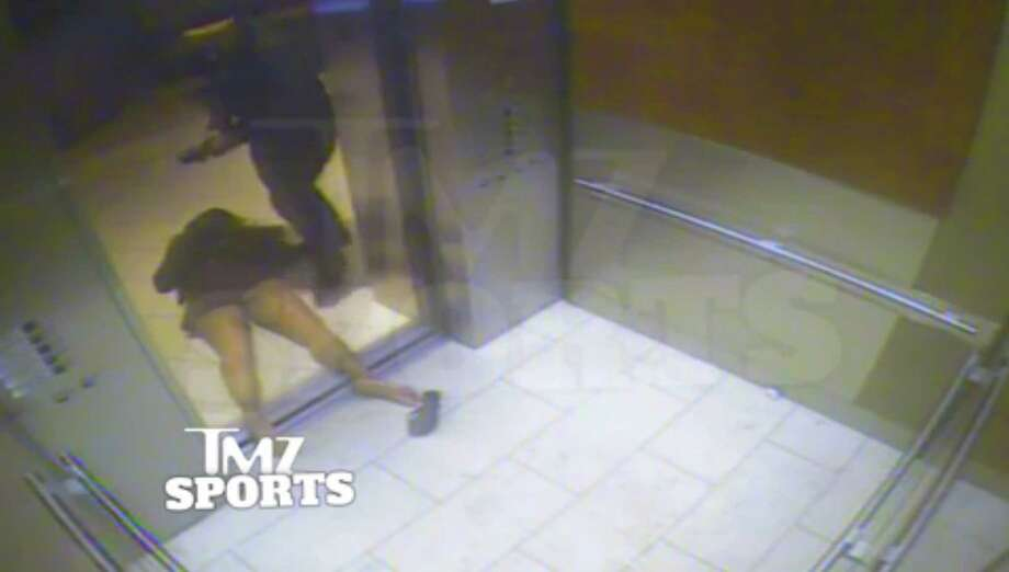 This still image taken from a hotel security video released by TMZ Sports shows Baltimore Ravens running back Ray Rice dragging his fiancée, Janay Palmer, out of an elevator moments after knocking her off her feet into the elevator's railing at the Revel casino in Atlantic City, N.J., in February 2014. Photo: The Associated Press File Photo  / Revels Security video via TMZ