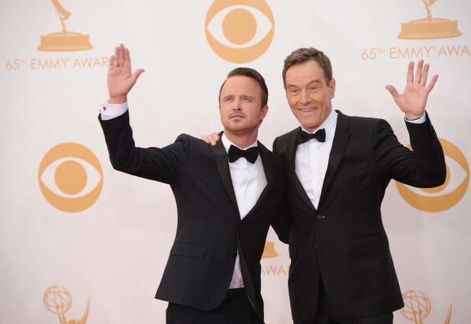 Breaking Bad actors Bryan Cranston (R) and Paul (L) arrive on the red carpet for the 65th Emmy Awards in Los Angeles, California, on September 22, 2013. AFP PHOTO / Robyn Beck (Photo credit should read ROBYN BECK/AFP/Getty Images) Photo: AFP/Getty Images / 2013 AFP