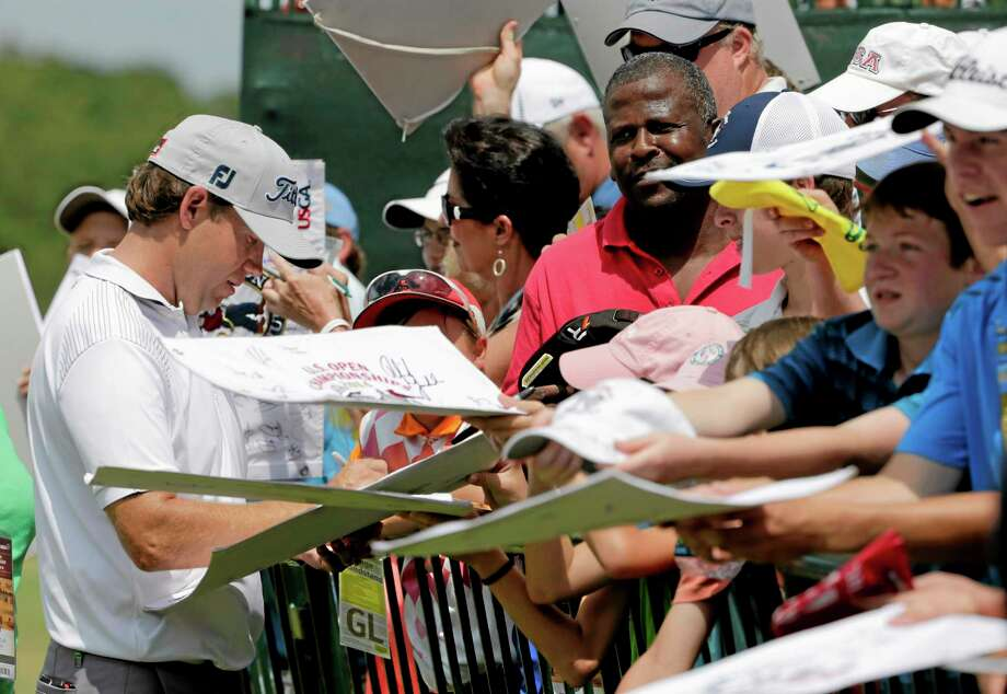 Erik Compton signs autographs after a practice round for the U.S. Open Tuesday in Pinehurst, North Carolina. Photo: Chuck Burton — The Associated Press  / AP