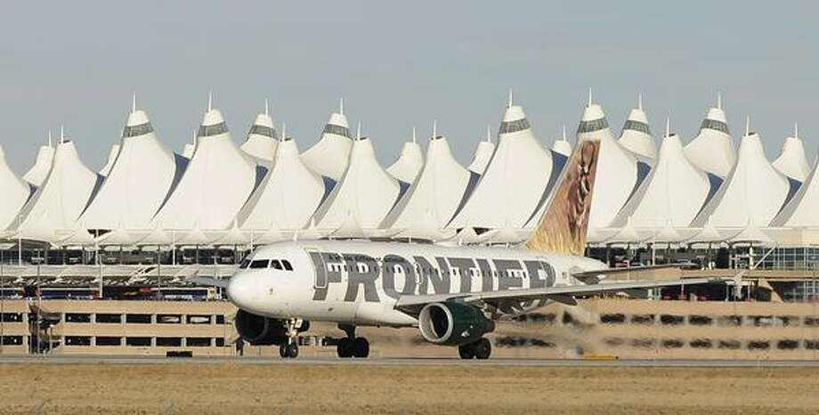 AIRPORTCAPACITY02-- Frontier is cutting capacity in 2009 at Denver International Airport. RJ Sangosti/ The Denver Post Photo: DP / THE DENVER POST