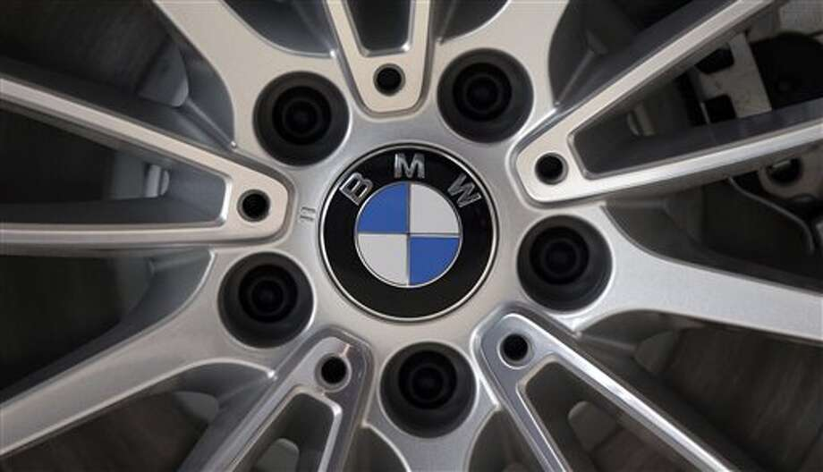 In this photo, the company logo of car manufacturer BMW is seen on a wheel rim in Munich, Germany. German carmaker BMW is recalling 176,000 vehicles from the model years 2012 to 2014 over a problem with the power brake system. (AP Photo/Matthias Schrader) Photo: AP / AP