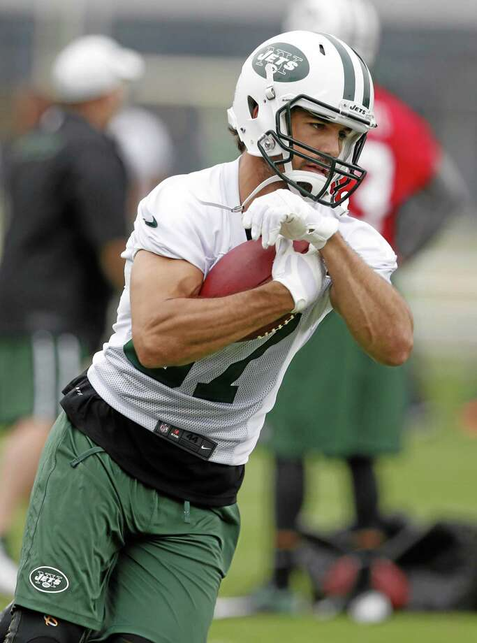 In this May 28 file photo, New York Jets wide receiver Eric Decker runs with the ball during an organized team activity in Florham Park, New Jersey. Photo: Julio Cortez — The Associated Press File Photo  / AP