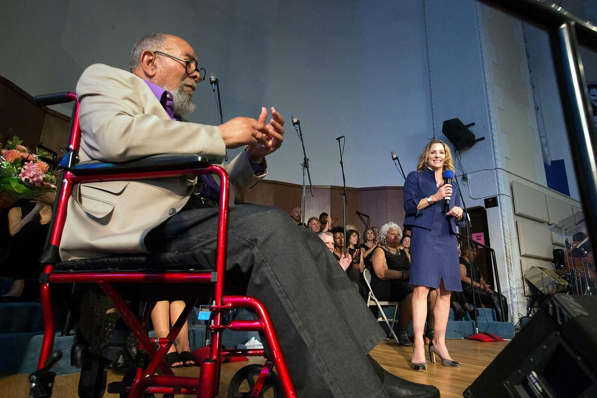 Glide Memorial Church co-founder Cecil Williams, left, introduces Karen Hanrahan, right, the church's new president and CEO, on Sunday, Aug. 27, 2017 in San Francisco, Calif. (D. Ross Cameron / Special to The Chronicle)
