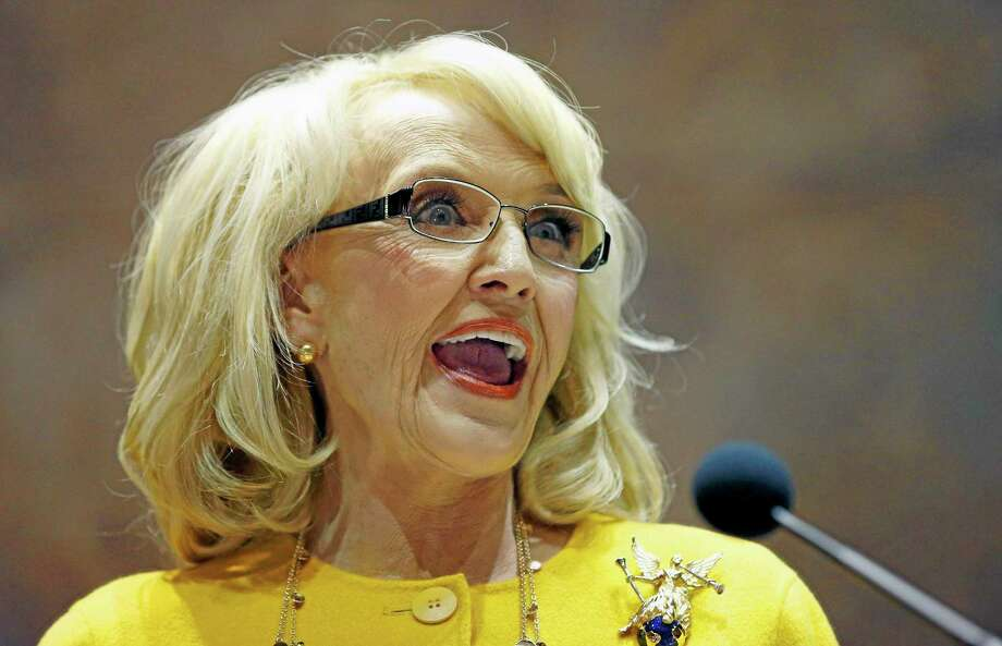 FILE - In this Jan. 13, 2014 file photo, Arizona Gov. Jan Brewer speaks during her State of the State address at the Arizona Capitol in Phoenix. The Republican governor faced intensifying pressure Tuesday from CEOs, politicians in Washington and state lawmakers in her own party to veto a bill that would allow business owners with strongly held religious beliefs to deny service to gays and lesbians. (AP Photo/Ross D. Franklin, File) Photo: AP / ap