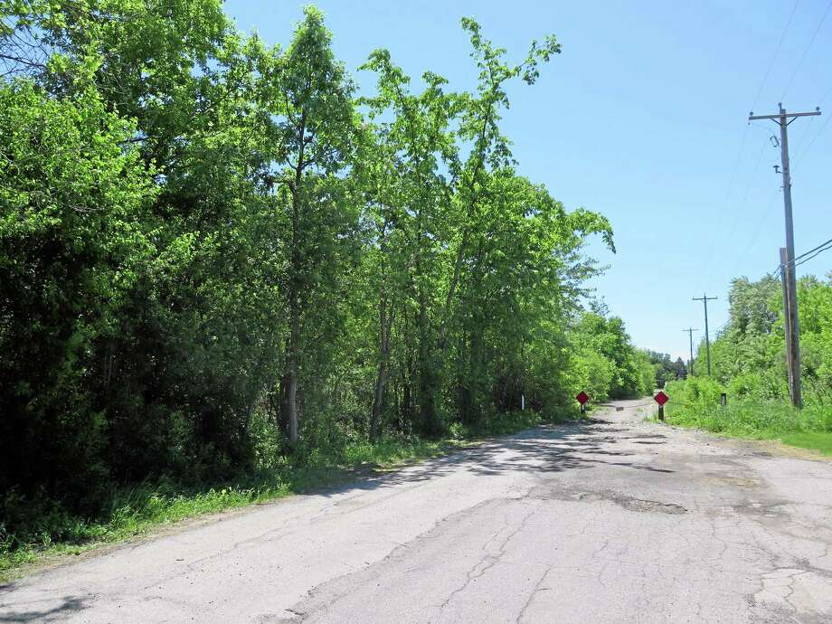FILE - The site in Waukesha, Wis., where a bicyclist found a 12-year-old girl who had 19 stab wounds is seen in this Tuesday June 3, 2014, file photo. Two 12-year-old girls are accused of stabbing the girl in the woods to please a fictional character they learned about online. Neighbors of the two accused say they're struggling to reconcile the allegations with what they know about the 12-year-olds and their upbringings. (AP Photo/Carrie Antlfinger, File) Photo: AP / AP